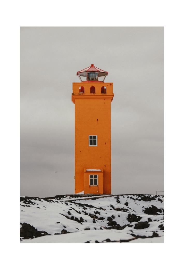 Svörtuloft pomarańczowa latarnia islandia